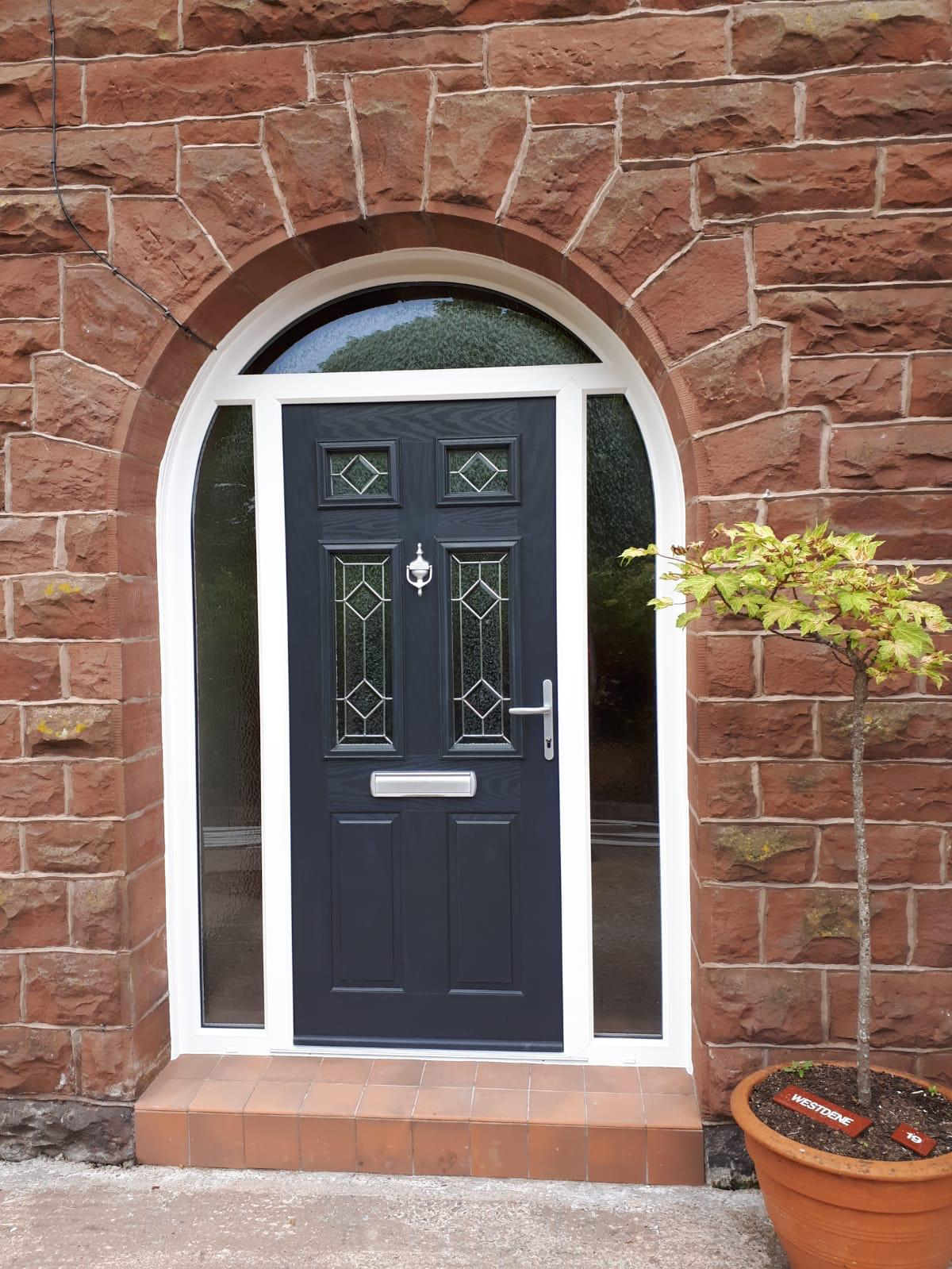 Arched Composite front door in blue with white frame
