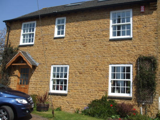 Brick building sliding sash